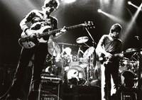 Grateful Dead: Phil Lesh and Bob Weir, with Bill Kreutzmann in the background