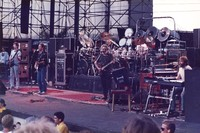 Grateful Dead: Phil Lesh, Bob Weir, Jerry Garcia, Bill Kreutzmann, Mickey Hart (obscured), and Brent Mydland