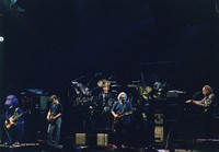 "Grateful Dead: Barney, Bob Weir, Bill Kreutzmann, Jerry Garcia, Mickey Hart (obscured), and Vince Welnick performing ""Aiko Aiko"""
