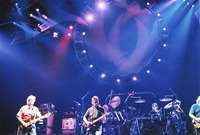 Grateful Dead: Phil Lesh, Bob Weir, with Bill Kreutzmann and Mickey Hart in the background