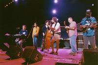 "Bruce Hornsby, Sherri Jackson, Rob Wasserman, Bob Weir, Jorma Kaukonen, and Michael Falzarano performing ""She Belongs To Me"" during the acoustic jam"