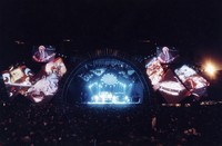 Grateful Dead, ca. 1992: distant view of the stage, with Jerry Garcia on the overhead screens