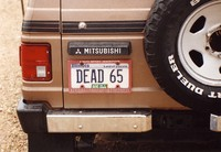 "Deadhead vehicle with ""DEAD 65"" Illinois license plate, ca. 1989"