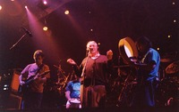 "Ken Nordine, with Bob Weir, Bill Kreutzmann and Mickey Hart, reciting either ""Flibberty Jib"" or ""The Island"" during ""Drumz"""