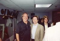 "Hugh ""Wavy Gravy"" Romney, Dennis McNally, and unidentified others"