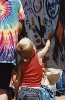 Memorial for Jerry Garcia: child painting on the banner