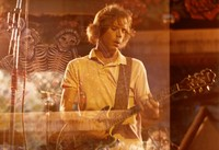 Bob Weir, with a double exposure of skeletons and roses