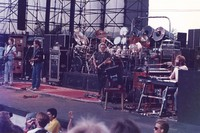 Grateful Dead: Phil Lesh, Bob Weir, Jerry Garcia, and Brent Mydland, with Bill Kreutzmann and Mickey Hart obscured