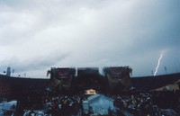 Grateful Dead at Soldier Field: distant view of the stage during a thunderstorm