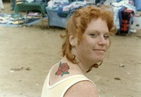 Deadhead with a painted rose on her back, ca. 1980s