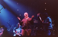 "Ken Nordine, with Bill Kreutzmann and Mickey Hart, reciting either ""Flibberty Jib"" or ""The Island"" during ""Drumz"""