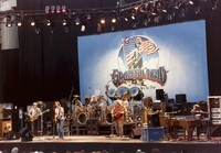 Grateful Dead: Phil Lesh, Bob Weir, Bill Kreutzmann, Jerry Garcia, Mickey Hart (obscured), Brent Mydland