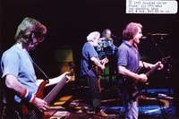Grateful Dead: Phil Lesh and Bob Weir, with Jerry Garcia and Vince Welnick in the background