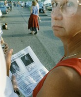 Unidentified woman holding a Pennsylvania State Police missing persons bulletin