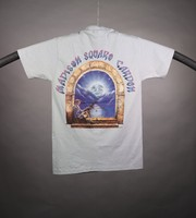 "T-shirt: ""Grateful Dead"" - skeleton sitting in stone arch, sun. Back: ""Madison Square Garden"" - skeleton sitting in stone arch, moon"