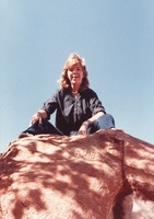 "Deadhead photographer, known as ""Moosie,"" atop a boulder in the Garden of the Gods"