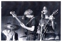 Grateful Dead: Phil Lesh and Bob Weir, with Bill Kreutzmann, obscured
