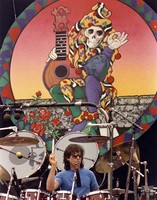Mickey Hart, beneath a Stanley Mouse jester backdrop