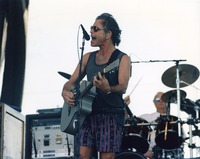 "Grateful Dead: Bob Weir performing ""When I Paint My Masterpiece"", with Bill Kreutzmann in the background"