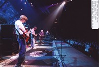 Grateful Dead: Phil Lesh, with Bob Weir, Jerry Garcia, and Vince Welnick in the background