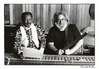Jerry Garcia and unidentified man at a recording studio panel, ca. 1986
