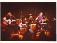 Grateful Dead during an acoustic set: Jerry Garcia, Mickey Hart, Bill Kreutzmann, Bob Weir, Phil Lesh (obscured) and Brent Mydland