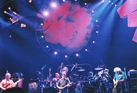 Grateful Dead: Phil Lesh, Bob Weir, and Jerry Garcia, with Bill Kreutzmann and Mickey Hart in the background