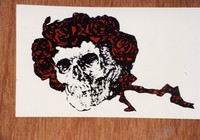 Grateful Dead merchandise: reproduction of the Skull and Roses design by Alton Kelley and Stanley Mouse, that was part of a display at an unknown location
