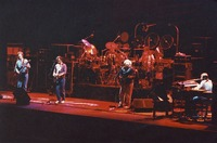 Grateful Dead, ca. 1980s: Phil Lesh, Bob Weir, Bill Kreutzmann (obscured), Jerry Garcia, Mickey Hart, and Brent Mydland