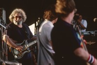 Grateful Dead: Jerry Garcia, Bob Weir, Phil Lesh, unidentified photographer (?) in the background