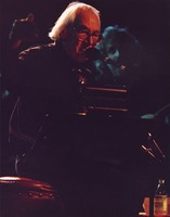 Ken Nordine performing with the David Grisman Quintet during the San Francisco Jazz Festival