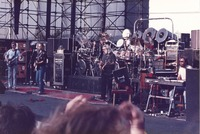 Grateful Dead: Phil Lesh, Bob Weir, Jerry Garcia, and Brent Mydland, with Bill Kreutzmann and Mickey Hart, obscured
