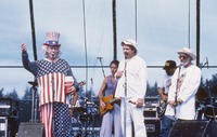 Ken Kesey and two unidentified performers, with Bob Weir and Michael Falzarano in the background