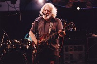 """Grateful Dead: Jerry Garcia and Mickey Hart (obscured) performing   """"Shakedown Street"""""""