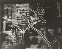 Grateful Dead imagery, ca. 1970s: skeleton running with a bottle in what appears to be a city shop window