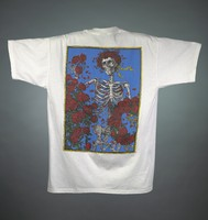 "T-shirt: ""Grateful Dead / 25"" - skull with rose circlet. Back: skeleton with rose circlet and wreaths"