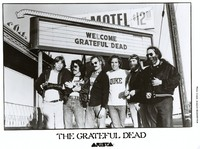 Grateful Dead publicity photograph for Arista in front of the Litchfield marquee: Phil Lesh, Mickey Hart, Bill Kreutzmann, Bob Weir, Brent Mydland, Jerry Garcia