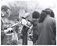 "Grateful Dead: Bob Weir, Phil Lesh, Jerry Garcia and Ron ""Pigpen"" McKernan with an unidentified photographer"