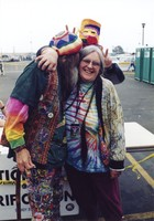 "Deadheads in the parking lot, woman with an ""Access All Areas"" laminate, ca. 1994"