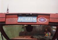 "Deadhead vehicle with ""LL RAIN"" New Jersey license plate, ca. 1990"