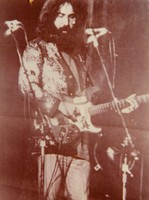 "Jerry Garcia, with the guitar, ""Alligator"", ca. 1972: photograph (ca. 1977) of newspaper image of 1972"