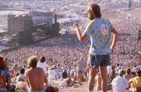 Grateful Dead, ca. 1990s: distant view of the stage, and Deadheads