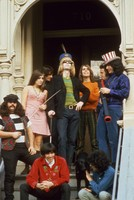 "Grateful Dead in front of 710 Ashbury Street: Ron ""Pigpen"" McKernan, unidentified woman, Bill Kreutzmann, Phil Lesh, Bob Weir, unidentified man, Jerry Garcia, and Rock Scully and Danny Rifkin in front"