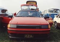 "Deadhead vehicle with ""DEDFUL"" Missouri license plate, ca. 1990"