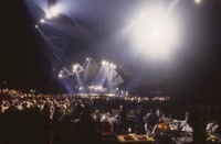 Grateful Dead, ca. 1993: stage lighting, unidentified crew members, and Deadheads