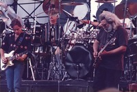 Grateful Dead: Bob Weir and Jerry Garcia, with Bill Kreutzmann and Mickey Hart, obscured