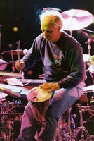 Bill Kreutzmann playing a talking drum