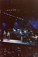 Grateful Dead, ca. 1988: Phil Lesh, Bill Kreutzmann (obscured), Bob Weir, Mickey Hart (obscured), Jerry Garcia, Brent Mydland