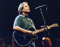 "Bob Weir performing ""Maggie's Farm"" with an acoustic guitar"