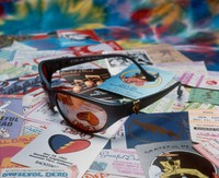 Grateful Dead merchandise: sunglasses displayed on top of backstage passes